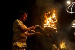 Hindu priests perform Agni Pooja Sanskrit: Worship of Fire on Dashashwamedh Ghat - main and oldest ghat of Varanasi. Royalty Free Stock Photos