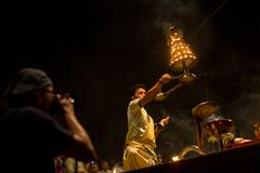 Hindu priests perform Agni Pooja Sanskrit: Worship of Fire on Dashashwamedh Ghat - main and oldest ghat of Varanasi located on t Stock Photo