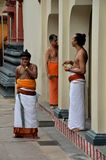 Hindu priests relax after morning rituals Royalty Free Stock Photo