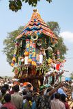 Hindu priests standing on decorated chariot during festival, Ahobilam, India Stock Photo