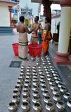 Hindu priests at temple prepare offering to gods Stock Photo