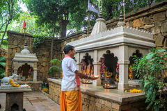 Hindu Puja. Worship being performed at temple Stock Image
