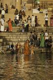 Two Women washing Away Their Sins. In Hindu religion it is believed that washing in the Ganges will rid you of your sins Royalty Free Stock Photography
