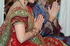 Hindu religious ceremony. A Hindu couple attend a ceremony for their unborn baby Royalty Free Stock Image