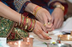 Hindu religious ceremony. A Hindu couple attend a ceremony for their unborn baby Royalty Free Stock Images