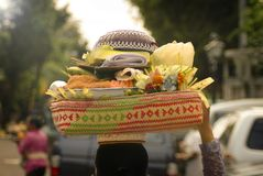 Balinese Hindu Offerings. At Hindu religious events beautiful and artistic offerings are taken to the temple to be blessed by the priest or holy man Royalty Free Stock Photo