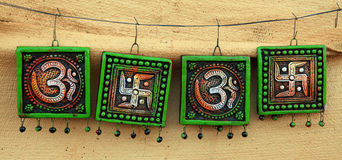Hindu religious signs. Hindu religious sign boards hanging on wire royalty free stock image