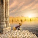 Hindu ritual. Young man doing a hindu ritual in the sunset Royalty Free Stock Photography