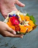 Hindu rituals. Hindu Religion Rituals,offering flowers to Ganga river Stock Photo