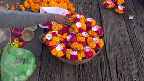Hindu sacred ceremony puja flowers on wooden table. Hindu sacred ceremony puja flowers on old wooden table stock video