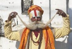Hindu Sadhu. Displays his big moustache at Pashupatinath Temple in Kathmandu, Nepal Royalty Free Stock Photos