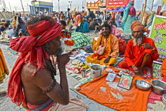 Hindu Sadhu. A Sadhu playing conch at the fair ground.Around 160 kms south of Kolkata on January 14, 2015. Sadhus and Hindu pilgrims from all over the country stock images