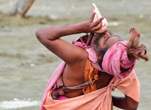 Hindu sadhu (saint) blowing conch. Stock Image