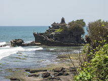 Hindu Sea Temple On Bali. Pura Tanah Lot is perhaps the best known Hindu sea temple on Bali. Carved from a single rock, the temple is located just of the shore Stock Photos