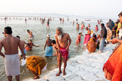 Hindu senior comes out from the water Royalty Free Stock Photo