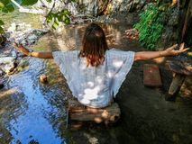 Girl doing yoga in the sea stock image