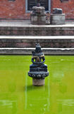 Hindu statue in a public fountain. Bhaktapur, Nepal Royalty Free Stock Images