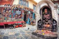 Hindu statue and Souvenir shop in Nepal Royalty Free Stock Photo