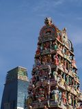 Hindu Statue Temple. Compared to modern architecture in the background Royalty Free Stock Photography