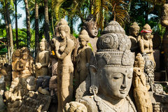 Hindu statues at factory. A large collection of Hindu religious statues is waiting for buyers at a factory on Bali Stock Photo