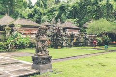 Hindu stone statue in the balinese temple. Tropical island of Bali, Indonesia. stock photos