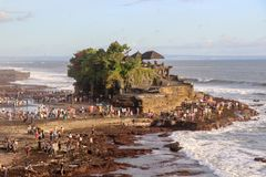 hindu tanah lot tempel at the coast of island of bali in indonesia with tourists around it royalty free stock images