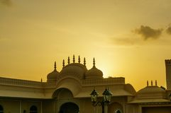 Hindu temple backlit by the setting sun on cloudy sky Royalty Free Stock Photo
