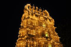 Hindu Temple in India illuminated at night. This temple as part of the ancient Mysore Palace in India is illuminated by thousands of lightbulbs every night Stock Image
