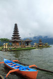 Hindu temple on lake in Bali, Indonesia. Balinese Hindu temple on lake with boat set in mountains of Bali, Indonesia royalty free stock images