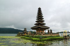 Hindu temple with many layers on lake in Bali, Indonesia. Balinese Hindu temple with lotus flowers on lake Bali, Indonesia stock photography