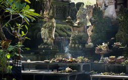 Hindu Temple Offerings. In the village of Ubud, Bali, the local market has its own temple and many people come to leave offerings called canang consisting of Royalty Free Stock Photography