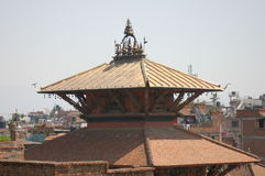 Hindu Temple Roof in Patan, Nepal. The roof of a Hindu temple in the city of Patan, near Kathmandu, Nepal royalty free stock photo