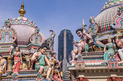 Hindu temple in Singapore with skyscraper. In background illustrates the balance between religious tradition and modern life Stock Image