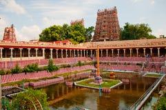 Hindu temple tower and tank Stock Photos