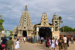Hindu temple in Trincomalee, Sri Lanka. Trincomalee, Sri Lanka - August 26, 2012: Crowd of devotees at Pathirakali Amman or Kali Kovil, hindu temple in the tamil Stock Photos