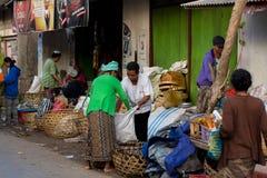 Hindu at the traditional street market, Bali. PENIDA ISLAND, INDONESIA - JUNE 22.2015: woman Hindu at the traditional daily street market, village Toyopakeh Royalty Free Stock Image