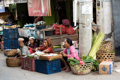 Hindu at the traditional street market, Bali. PENIDA ISLAND, INDONESIA - JUNE 22.2015: woman Hindu at the traditional daily street market, village Toyopakeh Royalty Free Stock Images