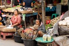 Hindu at the traditional street market, Bali. PENIDA ISLAND, INDONESIA - JUNE 22.2015: woman Hindu at the traditional daily street market, village Toyopakeh Stock Photography