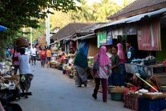 Hindu at the traditional street market, Bali. PENIDA ISLAND, INDONESIA - JUNE 22.2015: woman Hindu at the traditional daily street market, village Toyopakeh Royalty Free Stock Photography