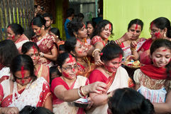 Hindu Vermilion ceremony. CALCUTTA - OCTOBER 6: Married Bengali Hindu women smear and play with vermilion during Sindur Khela traditional ceremony on the final Stock Image