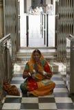 Hindu Woman. A Hindu Woman Praying at Deshnock Temple, Rajasthan, India Stock Photo