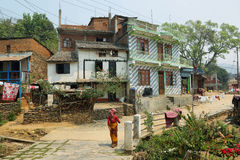 Hindu woman and beautiful traditional houses in Bandipur. BANDIPUR, NEPAL - APRIL 9 2016: hindu woman and beautiful traditional houses in Bandipur village, Nepal Stock Image