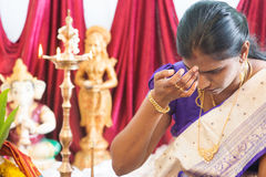 Hindu woman putting bindi. Or marking on her forehead during Indian traditional religious rituals, the tradition of Hinduism Stock Photos
