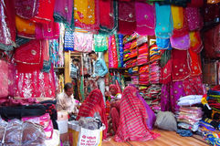 Hindu women dressed in colorful sari in Indian street market royalty free stock images