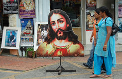 Hindu Women and Jesus Poster in Singapore Royalty Free Stock Image