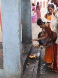 Hindu women make puja Stock Photo