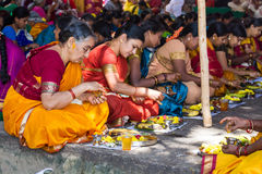 Hindu women making a ritual offering. Royalty Free Stock Photo