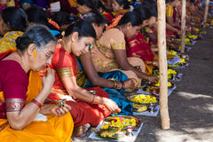 Hindu women making a ritual offering. Stock Photography