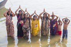 Hindu women pilgrims take bath in the Holy river Ganges . Varanasi, India. VARANASI, INDIA - JANUARY 26, 2017 : Unidentified Hindu women pilgrims take bath in Stock Photos