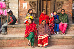 Hindu women in traditional sari sit on Old Durbar Square. Largest city of Nepal, its cultural center Royalty Free Stock Image